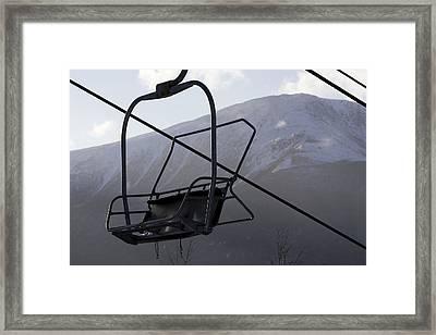 An Empty Chair Lift At A Ski Resort Framed Print by Tim Laman