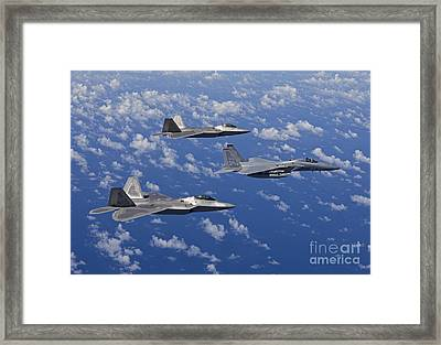 An F-15 Eagle And Two F-22 Raptors Fly Framed Print by HIGH-G Productions
