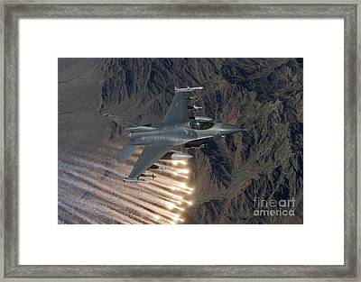 An F-16 Fighting Falcon Releases Flares Framed Print by HIGH-G Productions