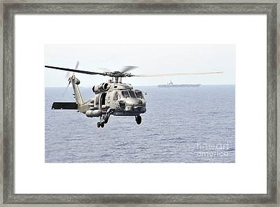 An Mh-60r Seahawk Helicopter In Flight Framed Print by Stocktrek Images