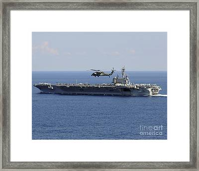 An Mh-60s Seahawk Helicopter Flies Framed Print by Stocktrek Images