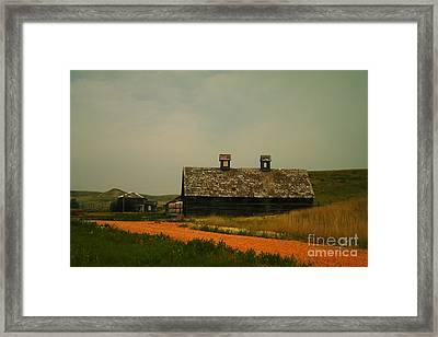 An Old Montana Barn Framed Print by Jeff Swan