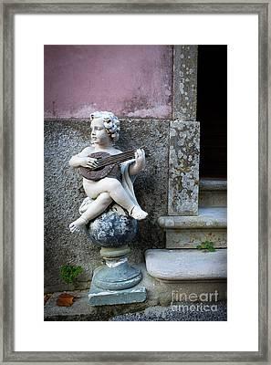 Angel Playing Framed Print by Carlos Caetano