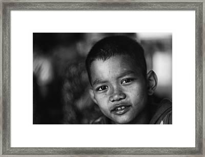 Angkor Wat Temple Boy Framed Print by David Longstreath