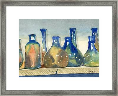 Antique Bottles Framed Print by Marsha Elliott