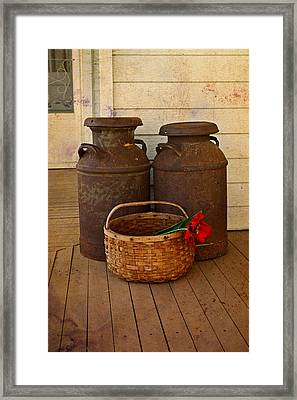 Antique Milk Cans On Porch Framed Print by Carmen Del Valle