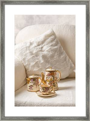Antique Teaset On Sofa Framed Print by Amanda And Christopher Elwell