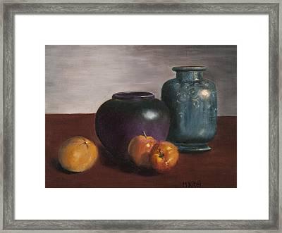 Apples To Orange Framed Print by Michael Kitei