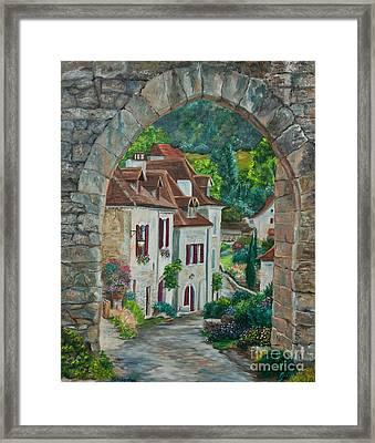Arch Of Saint-cirq-lapopie Framed Print by Charlotte Blanchard