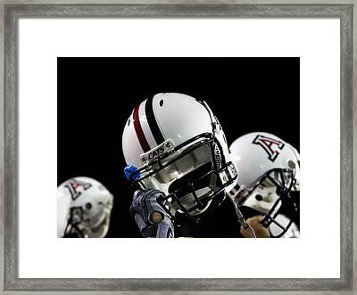 Arizona Football Helmets Framed Print by University of Arizona