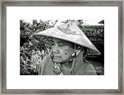 Asian Woman With A Mole On Her Cheek And Wearing A Conical Hat  Framed Print by Jim Fitzpatrick