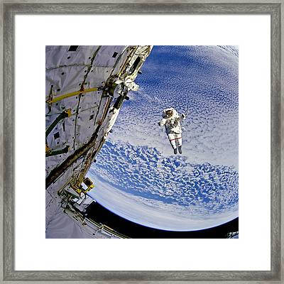 Astronaut In Atmosphere Framed Print by The  Vault - Jennifer Rondinelli Reilly