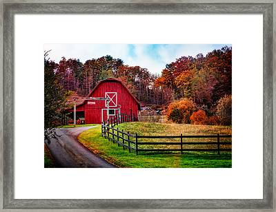 Autumn Red Barn Framed Print by Debra and Dave Vanderlaan