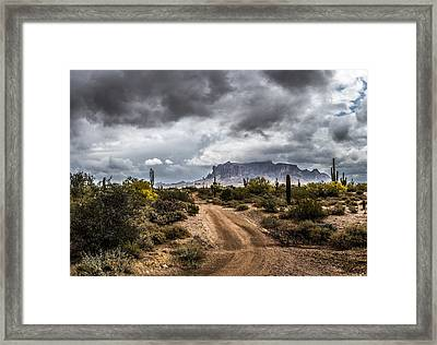 Backroad Storm Framed Print by Chuck Brown