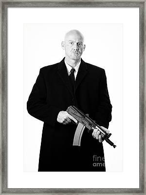 Bald Headed Man Wearing Heavy Black Overcoat Holding Ak-47 Framed Print by Joe Fox