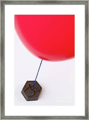 Balloon Tied To Weight Framed Print by Sami Sarkis
