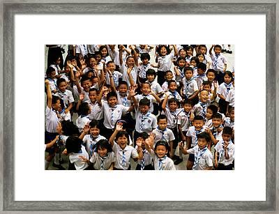 Bangkok School Children Jumping And Smiling At The Camera Framed Print by Sami Sarkis
