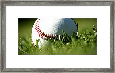 Baseball In Grass Framed Print by Chris Brannen