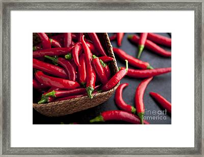 Basket Of Chilies Framed Print by Charlotte Lake
