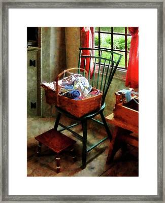 Basket Of Cloth And Yarn On Chair Framed Print by Susan Savad