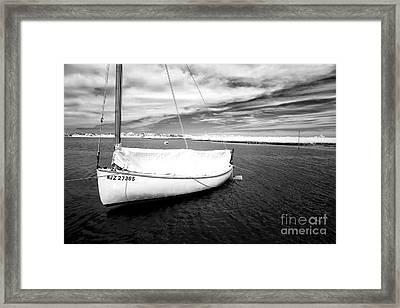 Bay Sailboat Framed Print by John Rizzuto