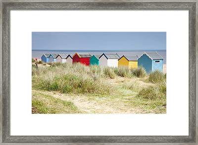 Beach Huts Framed Print by Ian Merton