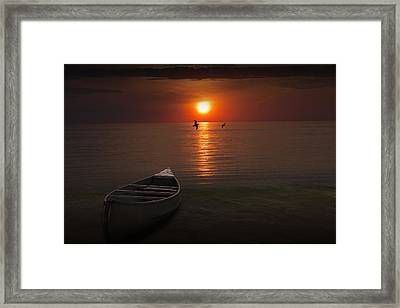 Beached Canoe During Sunset Framed Print by Randall Nyhof