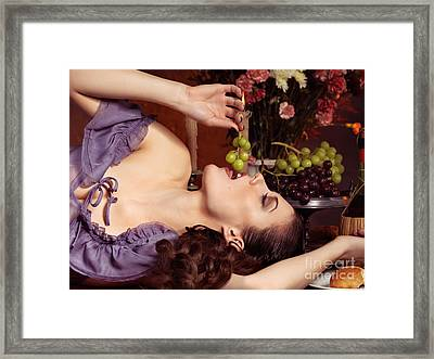 Beautiful Woman Eating Grapes On A Festive Table Framed Print by Oleksiy Maksymenko