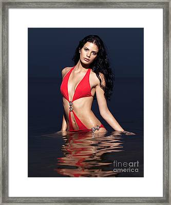 Beautiful Young Woman In Red Swimsuit Standing In Water Framed Print by Oleksiy Maksymenko