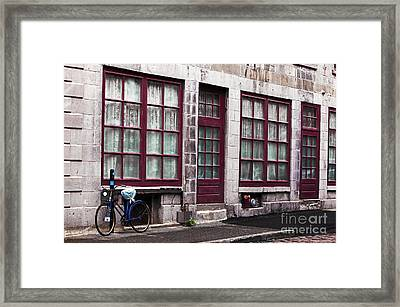 Bicycle In Old Montreal Framed Print by John Rizzuto