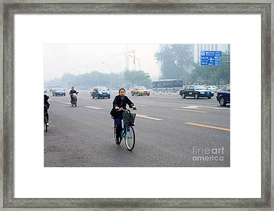 Bicyclist In Beijing Framed Print by Thomas Marchessault