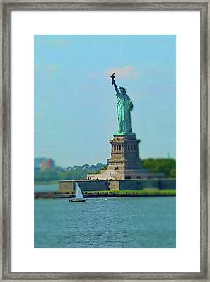 Big Statue, Little Boat Framed Print by Sandy Taylor
