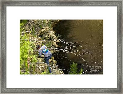Biologist Inspecting Sinkhole Framed Print by Inga Spence
