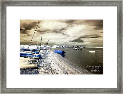 Blue Boat In The Water Framed Print by John Rizzuto