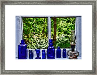 Blue Bottles On Window Sill Framed Print by Paul Ward