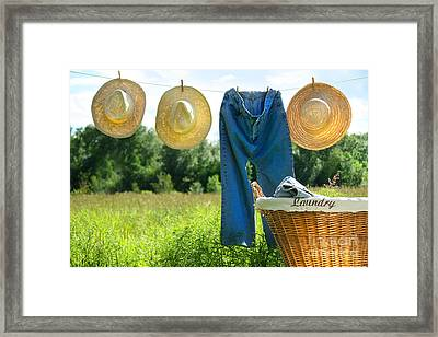 Blue Jeans And Straw Hats On Clothesline Framed Print by Sandra Cunningham
