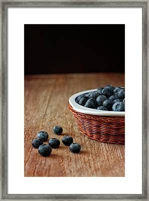 Blueberries In Wicker Basket Framed Print by © Brigitte Smith