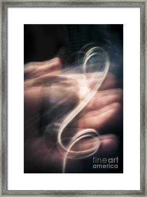 Blurry Human Hand Holding Distorted Music Player Framed Print by Jorgo Photography - Wall Art Gallery