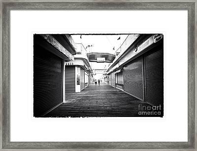 Boardwalk Joggers Framed Print by John Rizzuto