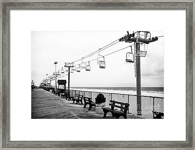 Boardwalk Ride Framed Print by John Rizzuto
