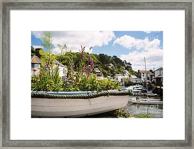 Boat Filled With Flowers Framed Print by Amanda Elwell