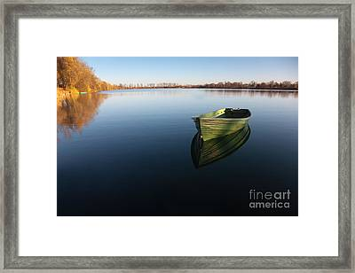 Boat On Lake Framed Print by Nailia Schwarz