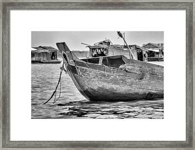 Boat On The Tonle Sap Framed Print by Georgia Fowler