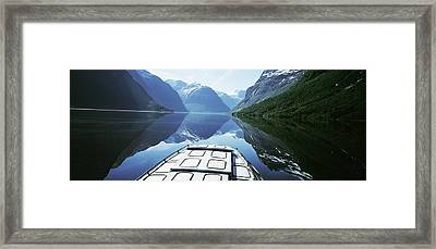 Boat Traveling Through Lavtn Lake Framed Print by Axiom Photographic