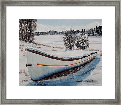 Boat Under Snow Framed Print by Marilyn  McNish