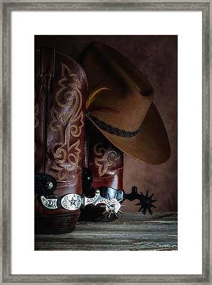 Boots And Spurs Framed Print by Tom Mc Nemar