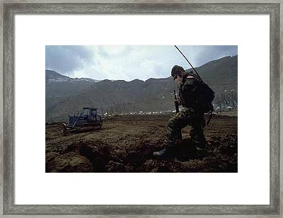Framed Print featuring the photograph Boots On The Ground by Travel Pics
