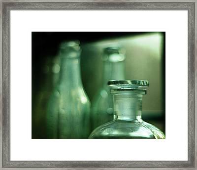 Bottles In The Window Framed Print by Rebecca Sherman