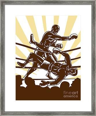 Boxer Knocking Out Framed Print by Aloysius Patrimonio