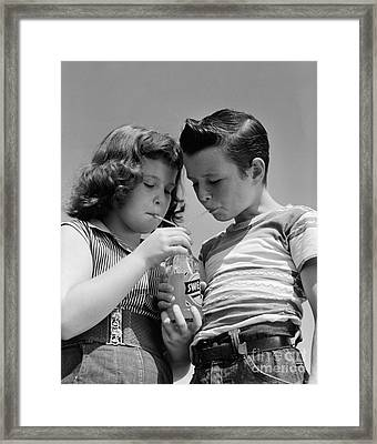 Boy And Girl Sharing A Soda, C.1950s Framed Print by H. Armstrong Roberts/ClassicStock